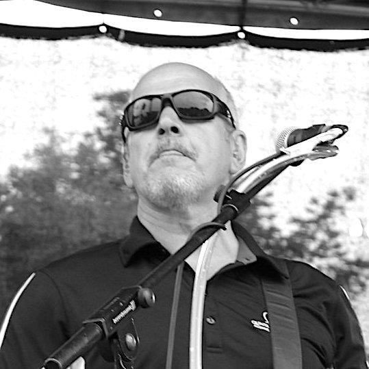 Dave Sykes playing guitar