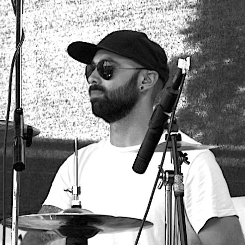 Tom Almgill playing drums